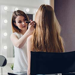beauty professional working with salon insurance